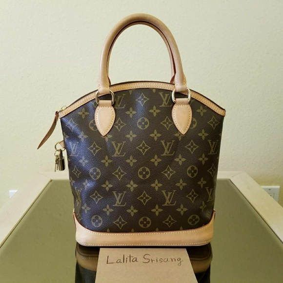 Louis Vuitton Handbags - Louis Vuitton Monogram Lockit PM in good condition